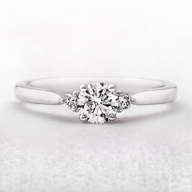 0.50ct White Gold Brilliant Solitaire With Diamond Shoulders