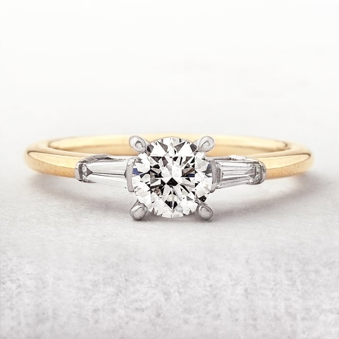 0.59ct Round Cut Yellow Gold Solitaire With Tappered Baquette Side Diamonds