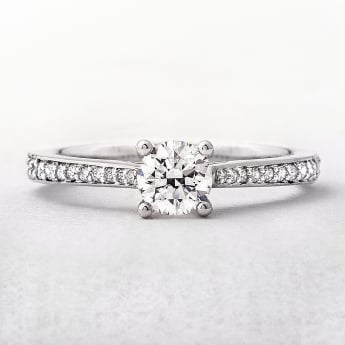 0.62ct White Gold Solitaire Diamond Ring With Diamond Set Shoulders