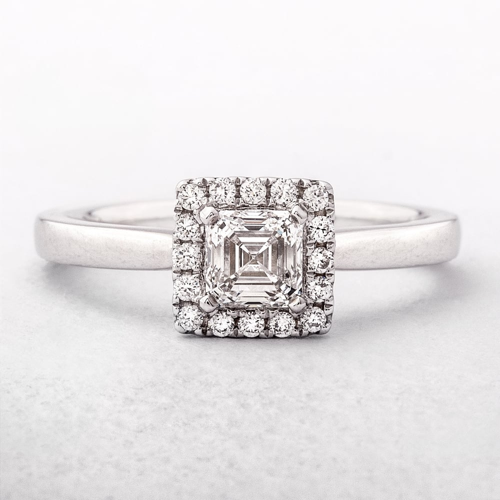 0af31ec062bc2 0.63ct Square Emerald Cut Diamond Halo Ring