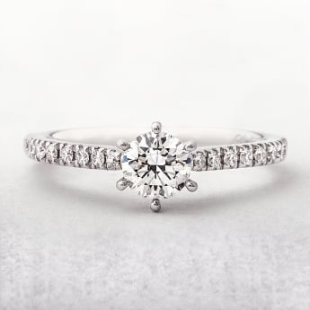 0.68ct White Gold Solitaire Diamond Ring With Diamond Set Shoulders