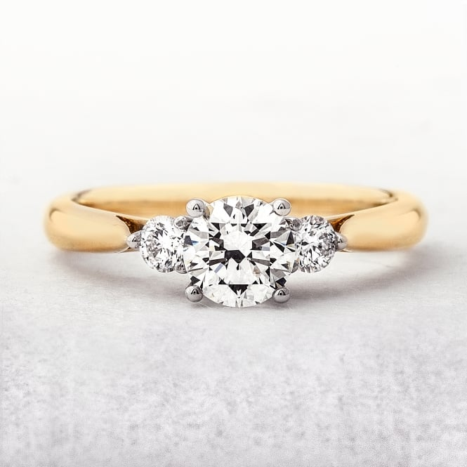 0.80ct Yellow Gold Solitaire Ring With Two Side Diamonds