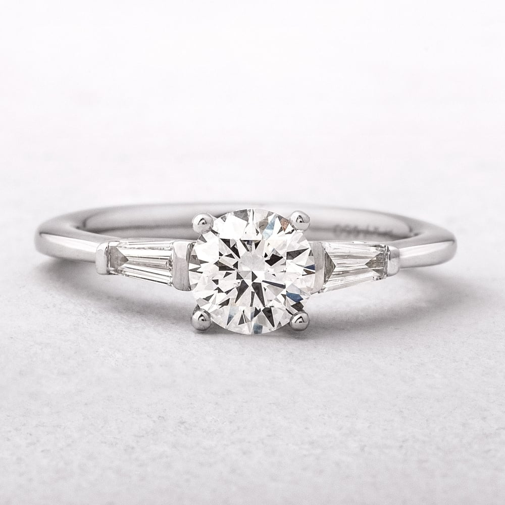 with rings emerald engagement cut stones ring side classic collections graff trilliant diamond square featuring a stone