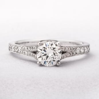 18ct White Gold Diamond Solitaire With Pave Set Diamond Shoulders
