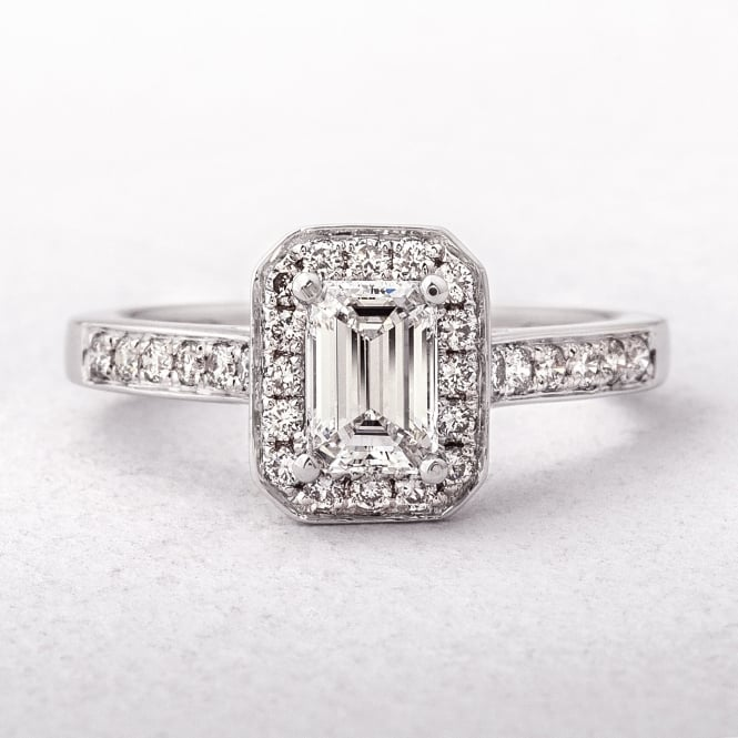 An Emerald Cut Diamond Halo Style Ring