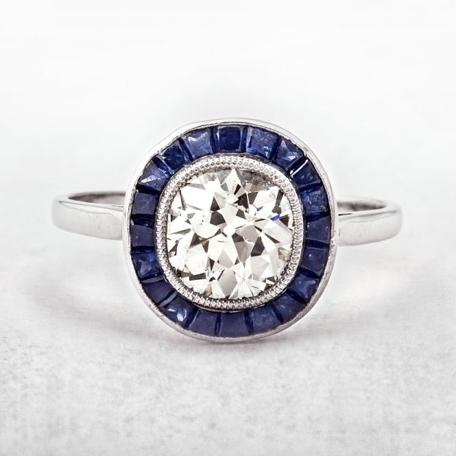 Diamond and Sapphire Halo Ring in Platinum