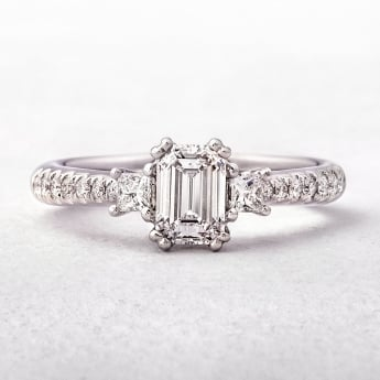Emerald Cut Diamond Solitaire Ring with Princess and Round Cut Diamonds